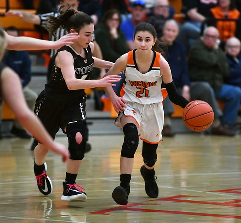 2/14/2020 Mike Orazzi | StaffrTerryville High School's Amy Roqi (21) and Thomaston's Sydney Stevenson (2) during Friday evening's girls basketball game in Terryville.