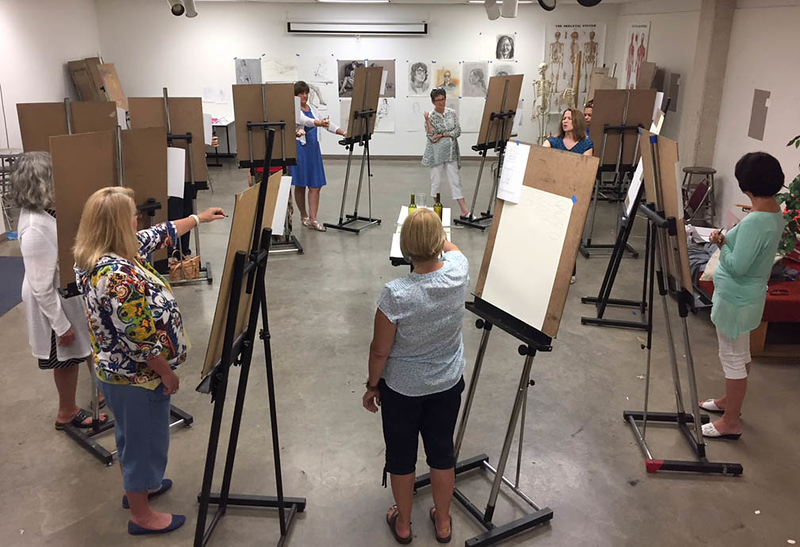 Meg Aubrey, Assistant Professor of Art & Design and Foundations Coordinator, leads nursing faculty in a drawing session designed to heighten awareness of observational and communication skills.