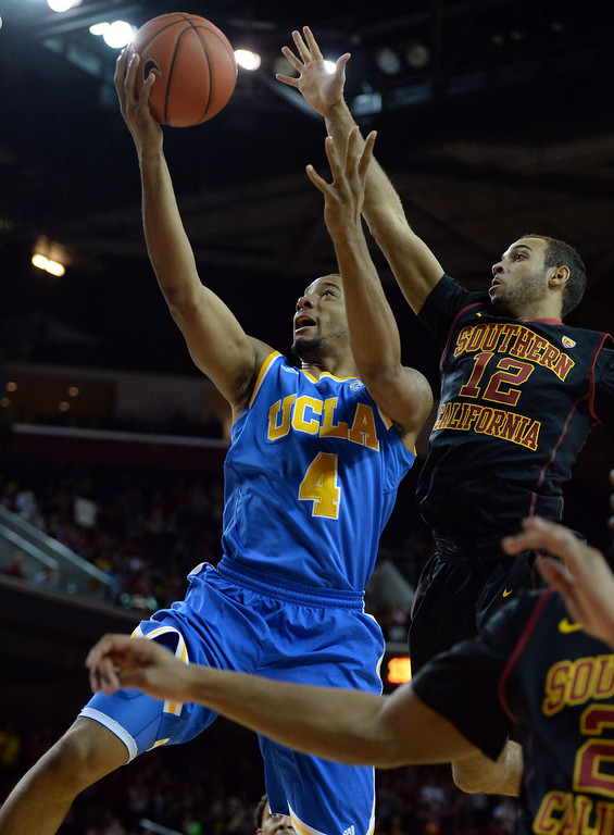 . UCLA\'s Norman Powell (4) drives to the basket over Southern California\'s Julian Jacobs (12) in the first half of a PAC-12 NCAA basketball game at Galen Center in Los Angeles, Calif., on Saturday, Feb. 8, 2014. (Keith Birmingham Pasadena Star-News)