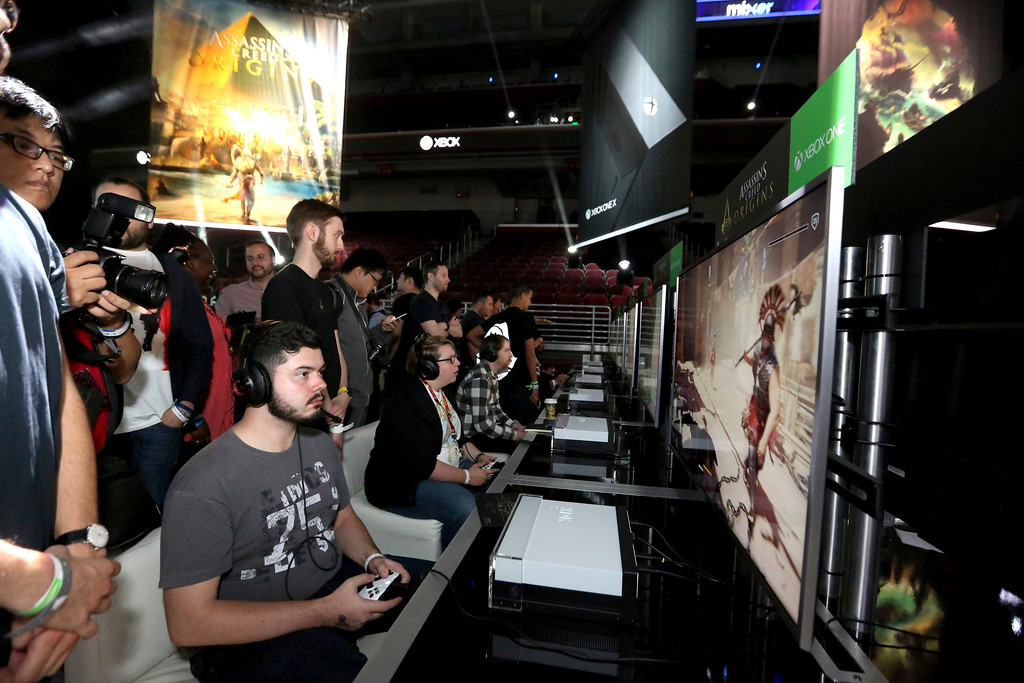 ". IMAGE DISTRIBUTED FOR MICROSOFT - Gamers play ""Assassins Creed Origins\"" at the Xbox Media Showcase at E3 2017 in Los Angeles on Monday, June 12, 2017. (Photo by Casey Rodgers/Invision for Microsoft/AP Images)"