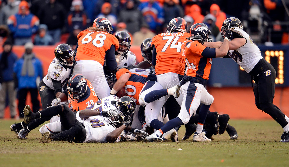 Description of . Denver Broncos running back Jacob Hester (40) works his way though the pile to gain a first down during the first half.  The Denver Broncos vs Baltimore Ravens AFC Divisional playoff game at Sports Authority Field Saturday January 12, 2013. (Photo by John Leyba,/The Denver Post)