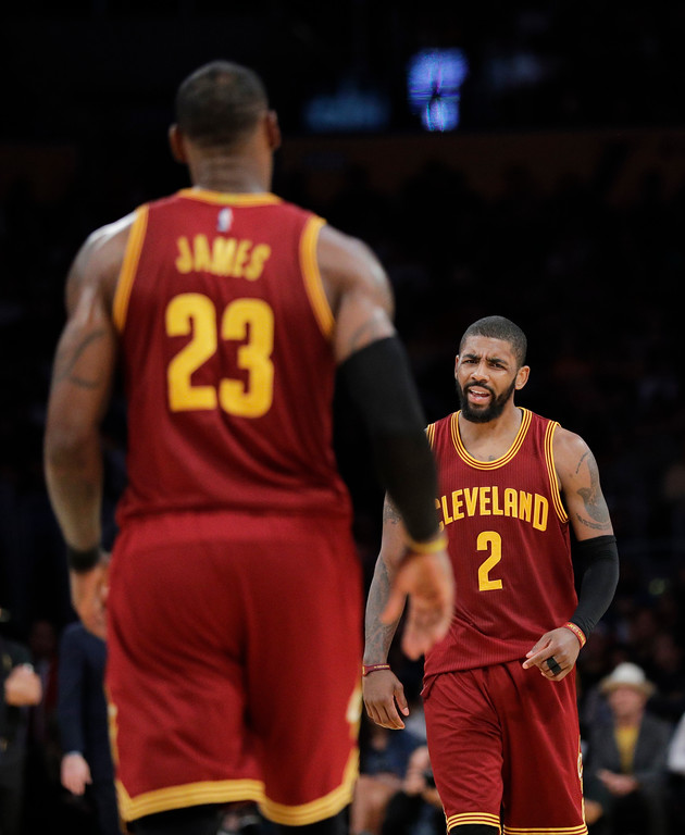 . Cleveland Cavaliers\' Kyrie Irving, right, reacts after LeBron James made a basket and drew a foul call against the Los Angeles Lakers during the second half of an NBA basketball game Sunday, March 19, 2017, in Los Angeles. The Cavaliers won 125-120. (AP Photo/Jae C. Hong)