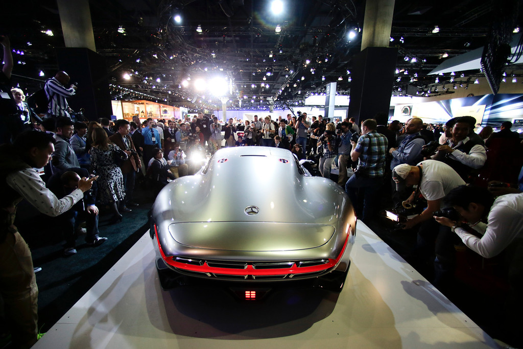 . People gather around the Mercedes-Benz AMG Vision Gran Turismo concept vehicle at the Los Angeles Auto Show on Wednesday, Nov. 20, 2013, in Los Angeles. (AP Photo/Jae C. Hong)