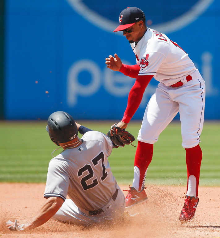 . New York Yankees\' Giancarlo Stanton (27) steals second base as Cleveland Indians\' Francisco Lindor attempts a tag during the fifth inning of a baseball game, Sunday, July 15, 2018, in Cleveland. (AP Photo/Ron Schwane)