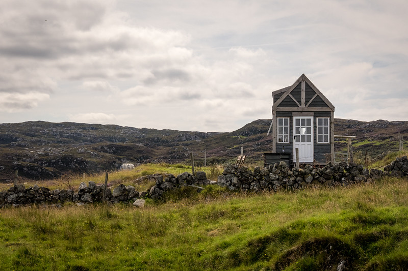 Tiny house on a hill in Scotland.