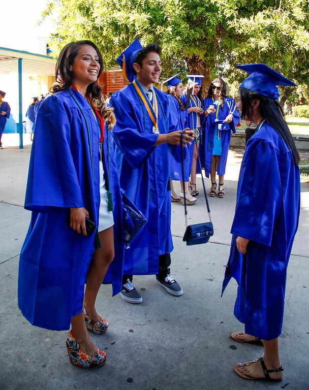 . Jessica Gonzalez, Richard Garcia and Karen Garcia wait for the call to line up for graduation, at John H Francis Polytechnic High School, Sun Valley, Calif., June 7, 2013. Photo: Lynn Levitt.