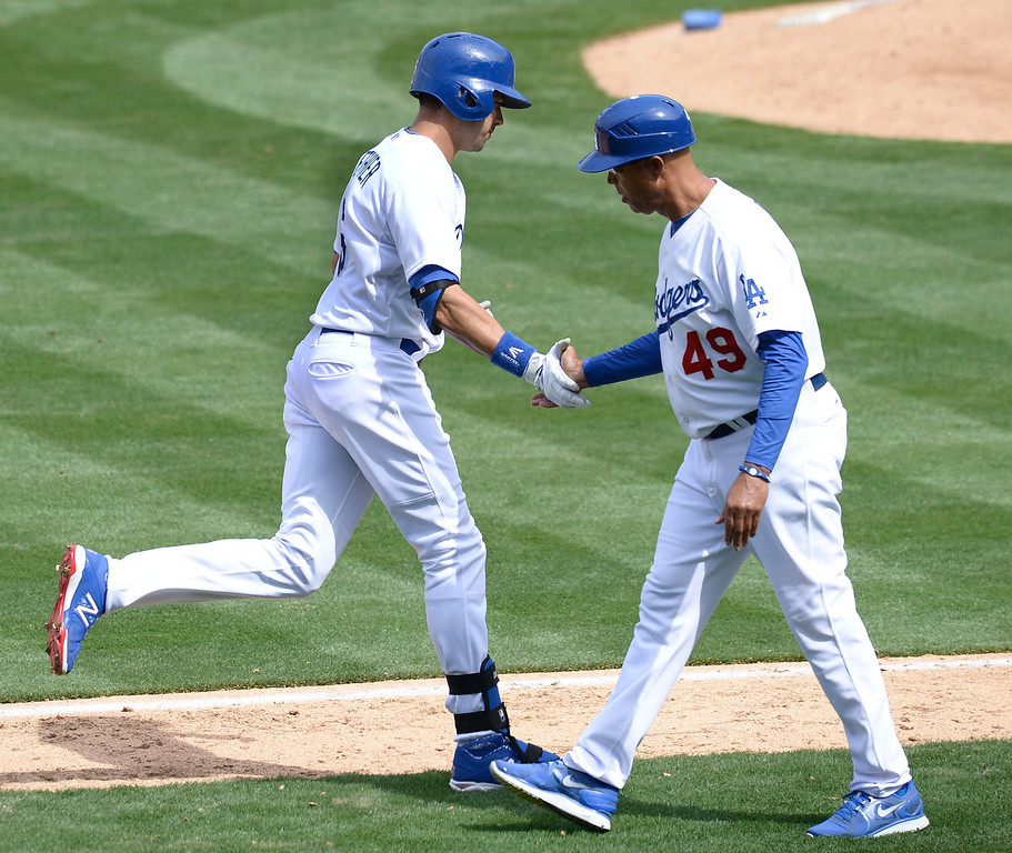 . Andre Ethier gets a hand shake from 3rd base coach Lorenzo Bundy after Ethier hit a home run in the 4th inning. The Dodgers played the San Francisco Giants on Opening Day at Dodger Stadium. Los Angeles, CA. April 3, 2014 (Photo by John McCoy / Los Angeles Daily News)