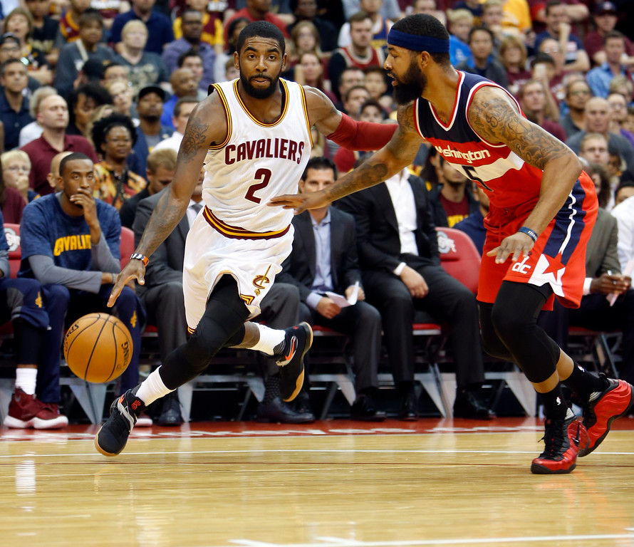 . Cleveland Cavaliers\' Kyrie Irving, left, drives past Washington Wizards\' Markieff Morris during the first half of an NBA preseason basketball game Tuesday, Oct. 18, 2016, in Columbus, Ohio. The Wizards defeated the Cavaliers 96-91. (AP Photo/Jay LaPrete)