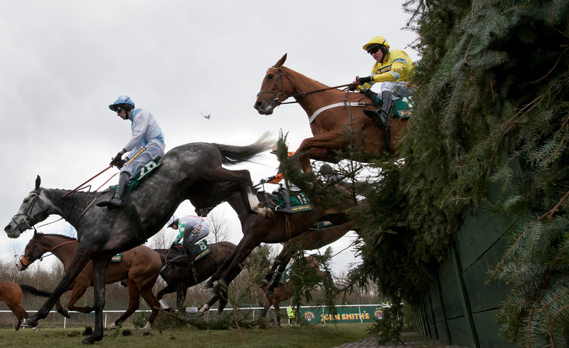 . Triolo D\'alene ridden by Barry Geraghty, right, clears Beechers Brook on his way to winning the Steeple Chase during Ladies\' Day at Aintree Racecourse Liverpool, England, Friday, April 5, 2013. (AP Photo/Jon Super)