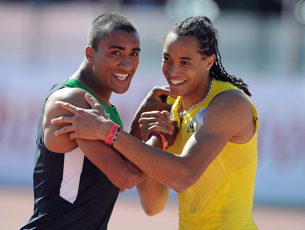 . Ashton Eaton, left,  finished third in the 110 meter hurdles invitational elite shakes hands with Pascal Martinot-Lagarde of France who finished second during the Mt. SAC Relays in Hilmer Lodge Stadium on the campus of Mt. San Antonio College on Saturday, April 20, 2012 in Walnut, Calif.    (Keith Birmingham/Pasadena Star-News)
