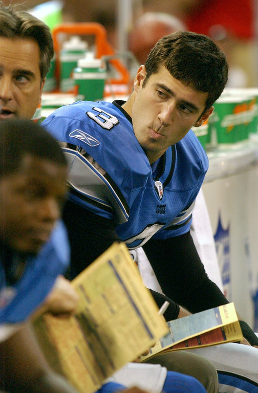 . Detroit Lions quarterback Joey Harrington, right, sits and listens to head coach Steve Mariucci after being benched, and replaced by Mike McMahon, during third quarter action, Sunday, October 19, 2003, at Ford Field in Detroit, Mich.  Dallas beat Detroit, 38-7.