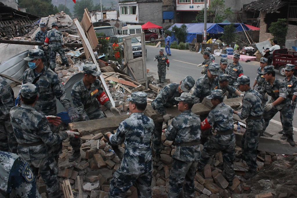 . LUSHAN, CHINA - APRIL 25:  (CHINA OUT) Rescuers clean up the debris at Gucheng village on April 25, 2013 in Lushan County, China. A powerful earthquake struck the Lushan county of China\'s southwestern Sichuan province on the morning of April 20, leaving at least 196 people dead and more than 12,200 injured.  (Photo by ChinaFotoPress/ChinaFotoPress via Getty Images)
