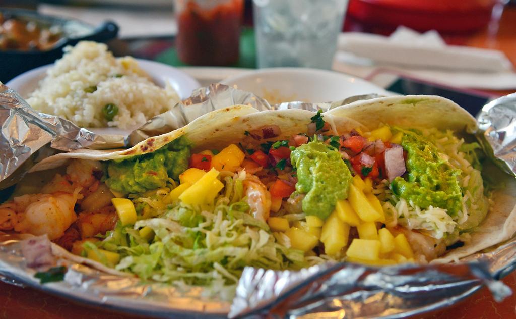 . El Mazatlan\'s shrimp tacos are stuffed with juicy shrimp, mangos, pico de gallo and guacamole.  (Pioneer Press: C.J. Sinner)