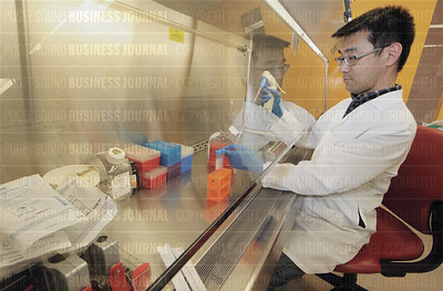 Omeros scientists work in their biotechnology laboratories in Seattle, Washington