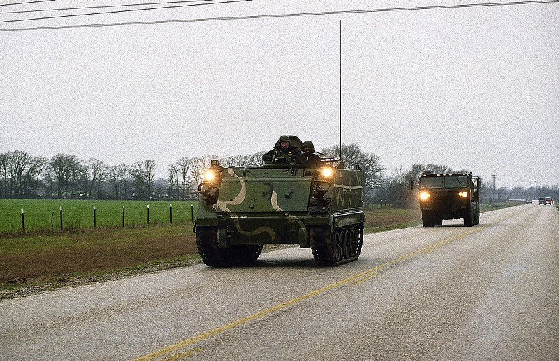 . A Texas National Guard armored personnel carrier heads towards the Mount Carmel compound of the Branch Davidians cult near Waco, Texas on Sunday, Feb. 28, 1993. Federal and local law enforcement officials are at a standoff with the cult after cult members opened fire on Alcohol, Tobacco and Firearms agents, killing at least four and wounding 15, as they attempted to execute a search warrant on Sunday morning. (AP Photo/Pat Sullivan)