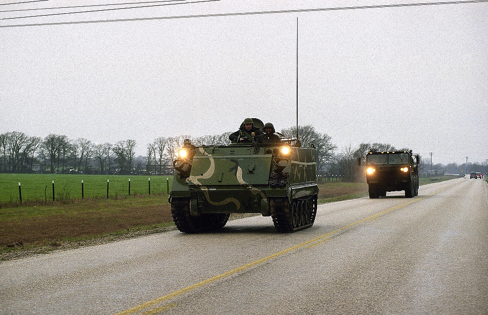 Description of . A Texas National Guard armored personnel carrier heads towards the Mount Carmel compound of the Branch Davidians cult near Waco, Texas on Sunday, Feb. 28, 1993. Federal and local law enforcement officials are at a standoff with the cult after cult members opened fire on Alcohol, Tobacco and Firearms agents, killing at least four and wounding 15, as they attempted to execute a search warrant on Sunday morning. (AP Photo/Pat Sullivan)