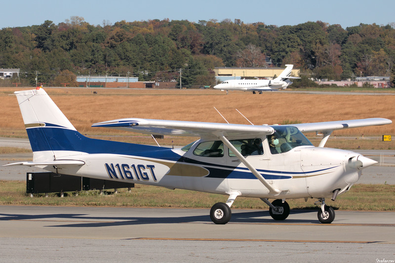 CESSNA 172P   C/n 17276650   N161GT Dekalb Peachtree (KPDK), Ga, 11/16/2020, Departing for Ball Ground, GA, USA In background Dassault Aviation Falcon 2000EX c/n 331  N421SC  STRYKER CORP KALAMAZOO , MI, US  This work is licensed under a Creative Commons Attribution- NonCommercial 4.0 International License.