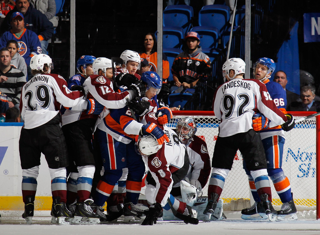 . UNIONDALE, NY - NOVEMBER 11: Kyle Okposo #21 of the New York Islanders is stopped in front of the Colorado Avalanche crease during the first period at the Nassau Veterans Memorial Coliseum on November 11, 2014 in Uniondale, New York.  (Photo by Bruce Bennett/Getty Images)