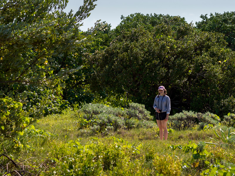 Woman in forest, Half Moon Caye, Lighthouse Reef Atoll, Belize
