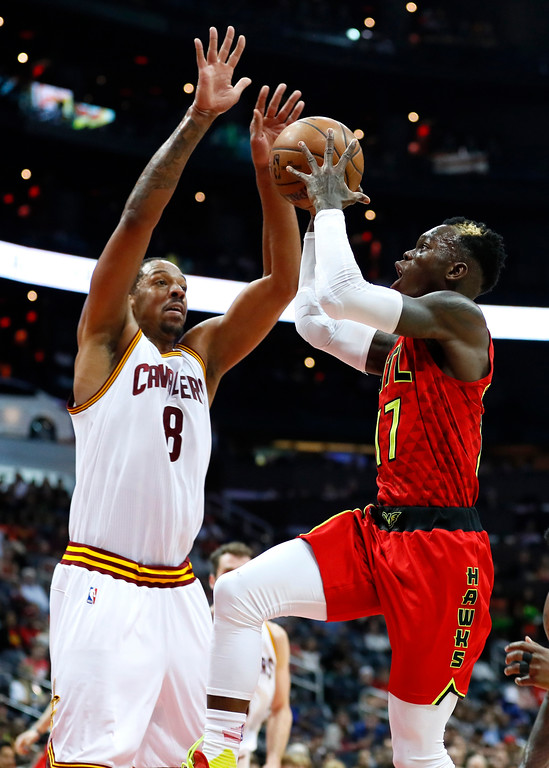 . Atlanta Hawks guard Dennis Schroder (17) goes up for a shot as Cleveland Cavaliers forward Channing Frye (8) defends in the first half of an NBA basketball game, Sunday, April 9, 2017, in Atlanta. (AP Photo/Todd Kirkland)