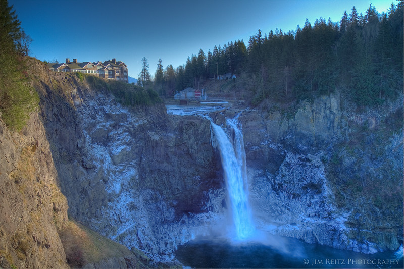 Icy Snoqualmie Falls in winter.