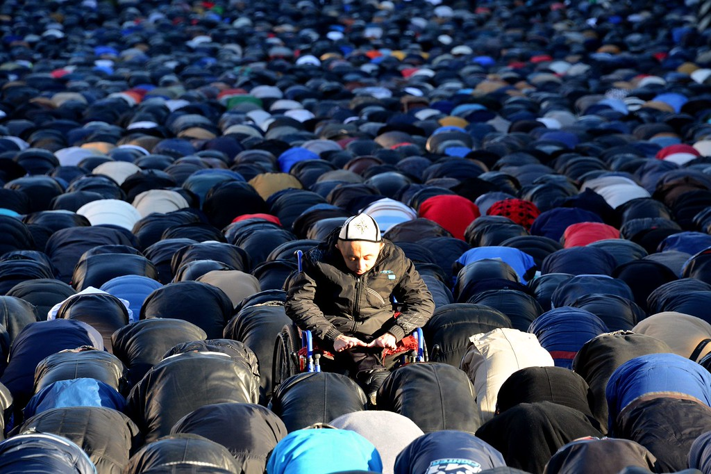 . Russian Muslims pray outside Moscow\'s central mosque on October 15, 2013, during celebrations of Eid al-Adha (Kurban Bayram).   AFP PHOTO/KIRILL KUDRYAVTSEV/AFP/Getty Images
