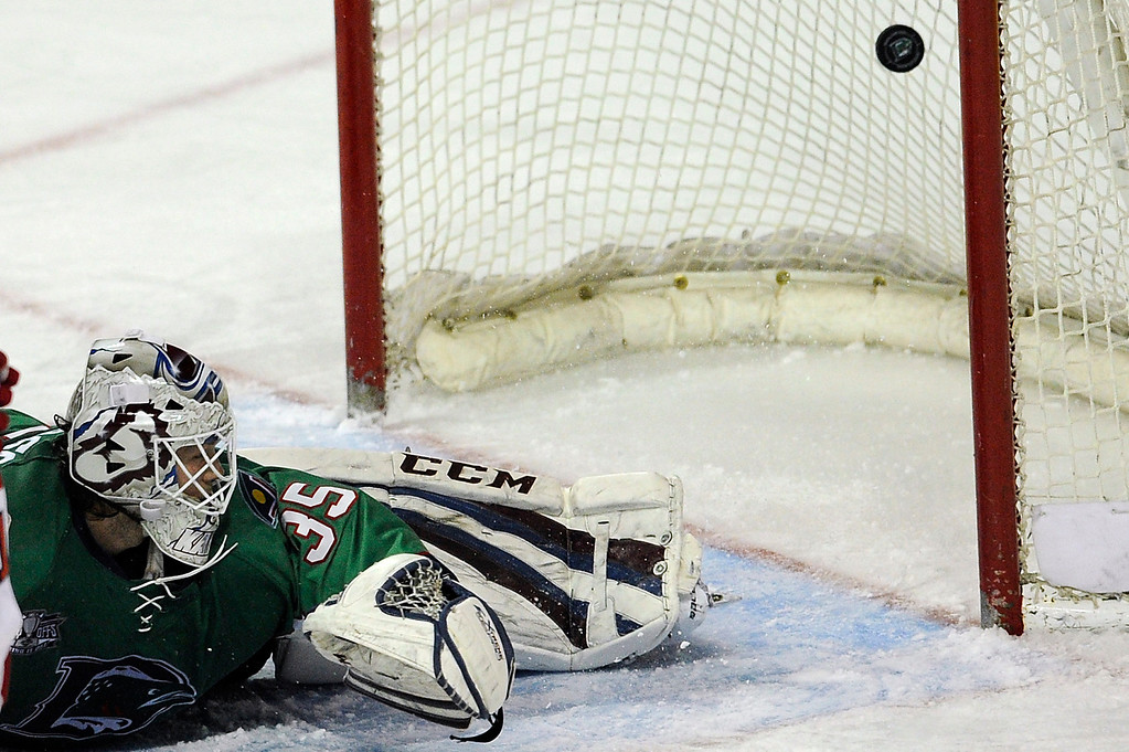 . DENVER, CO - MAY 2: Denver Cutthroats goalie Kent Patterson (35) looks back and watches the puck sail into the net for the Allen Americans during the second period of game 1 of the Ray Miron Presidents Cup Finals at the Denver Coliseum in Denver, Colorado on May 2, 2014. (Photo by Seth McConnell/The Denver Post)