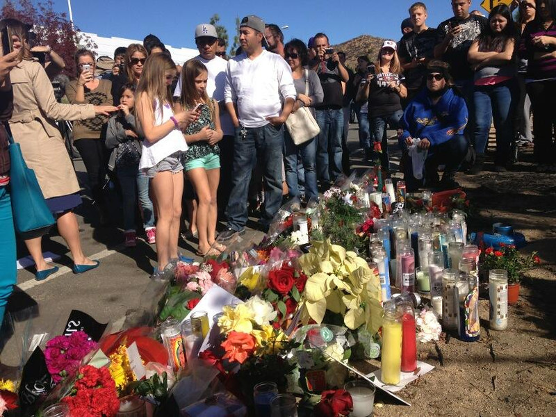 . More than 100 are gathered on Dec. 1, 2013, at the makeshift memorial for actor Paul Walker and business partner Roger Rodas, who died in a fiery Valencia crash on Nov. 30. (Photo by Brenda Gazzar/Los Angeles Daily News)
