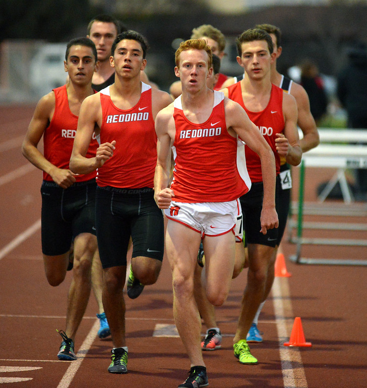. 05-03-2013-(LANG Staff Photo by Sean Hiller)-  The Bay League track and field finals Friday night at Mira Costa High School. Dustin Herold leads the pack to win the boys varsity 800.