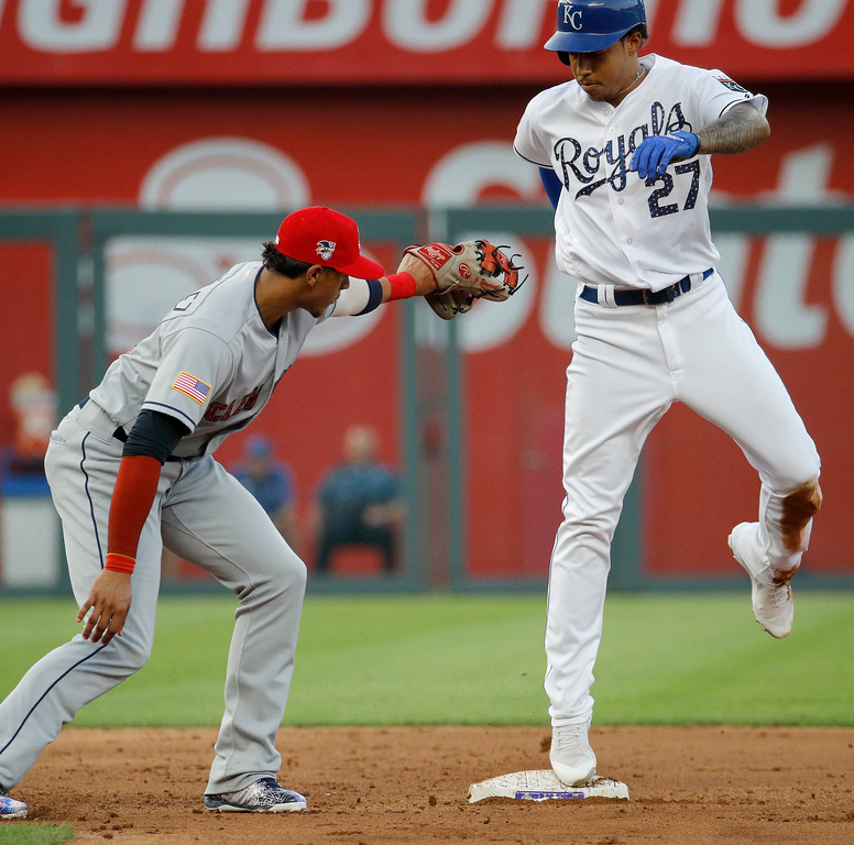 . Kansas City Royals\' Adalberto Mondesi (27) beats the tag by Cleveland Indians second baseman Erik Gonzalez to steal second during the second inning of a baseball game Tuesday, July 3, 2018, in Kansas City, Mo. (AP Photo/Charlie Riedel)