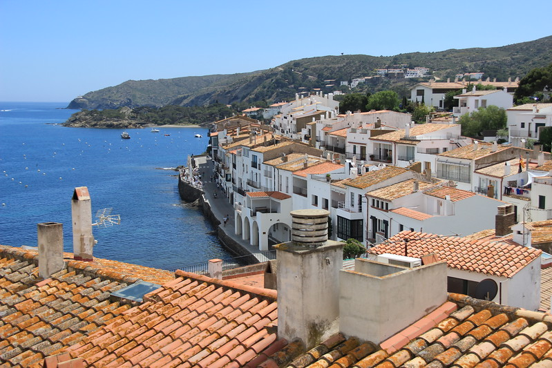 The whitewashed village of Cadaques overlooks the blue sea, one of many day trips from Girona.