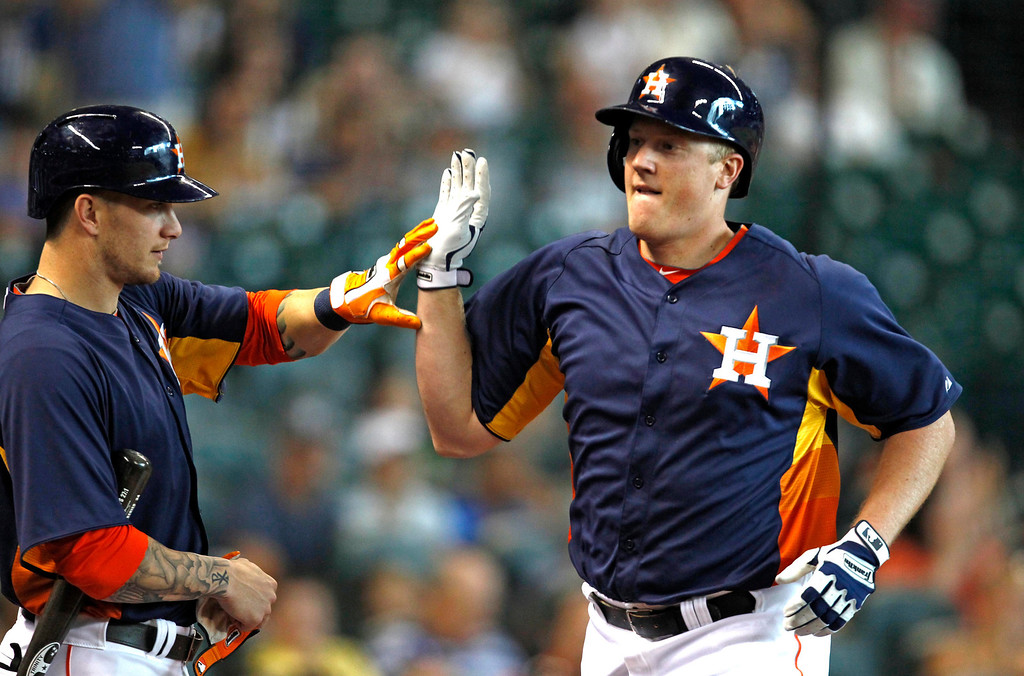. Houston Astros\' Marc Krauss, right, is congratulated by teammate Brandon Barnes after hitting a solo home run in the second inning of a baseball game against the Los Angeles Angels Sunday, Sept. 15, 2013, at Minute Maid Park in Houston. (AP Photo/Eric Christian Smith)