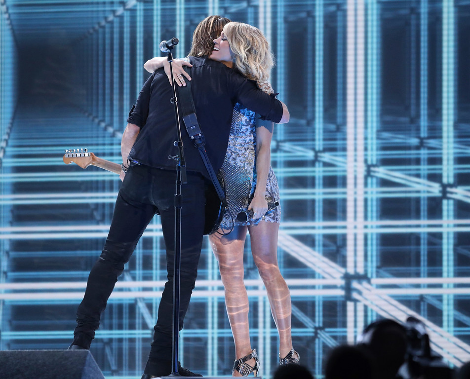 ". Keith Urban, left, and Carrie Underwood embrace after a performance of ""The Fighter\"" at the 59th annual Grammy Awards on Sunday, Feb. 12, 2017, in Los Angeles. (Photo by Matt Sayles/Invision/AP)"