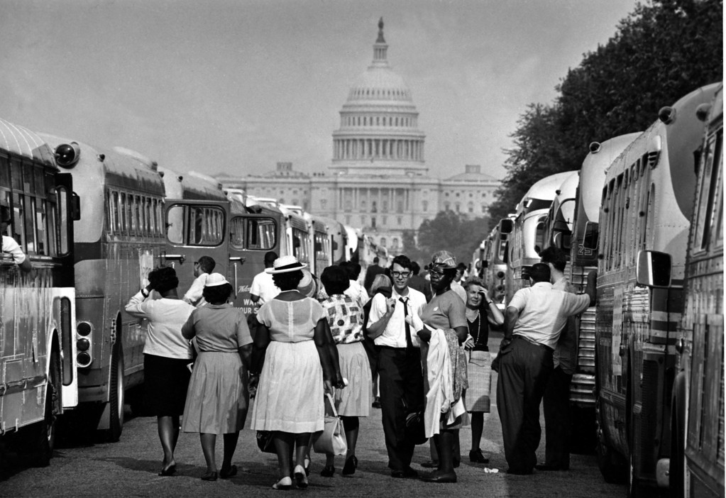 . With the U.S. Capitol in the background, passengers for charter busses walk along a service roadway of the Mall in Washington, August 28, 1963, to find their transportation home after a civil rights demonstration estimated by police at more than 200,000 people.  (AP Photo)