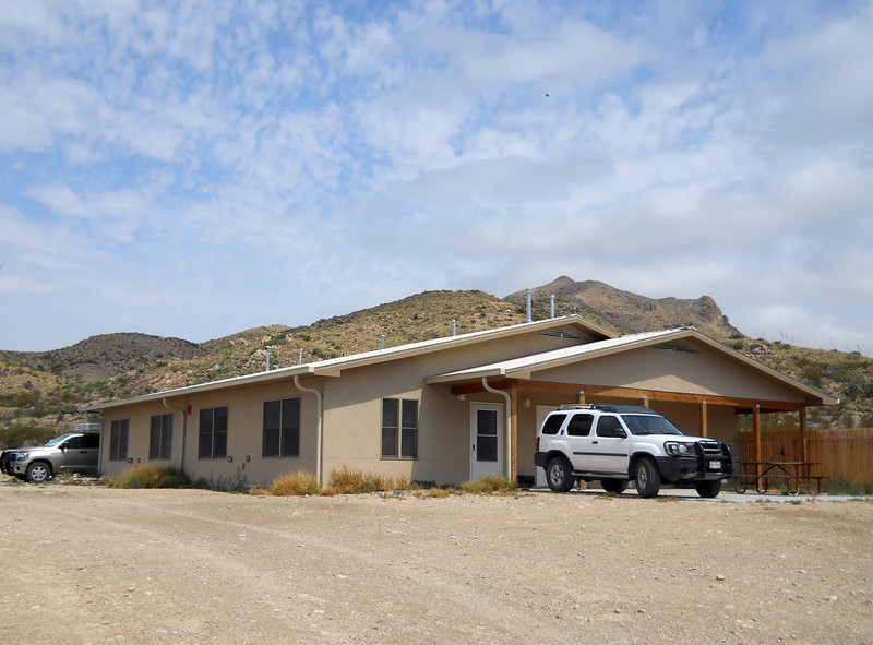 RANCHO DELUXE BIG BEND Persimmon Gap Apartments  And here we are, at the bottom of the drive looking up at my new apartment. It's so nice to be able to back Annie right up to the door under the overhang so unloading on rainy days (yeah, when was that?) . . .  okay, on very sunny days (that's better!) you don't have to worry about the sun beating right on your noggin. Notice the fenced-in back yard (jungle).