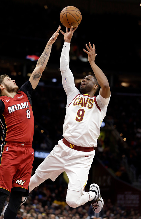 . Cleveland Cavaliers\' Dwyane Wade (9) shoots over Miami Heat\'s Tyler Johnson (8) in the first half of an NBA basketball game, Tuesday, Nov. 28, 2017, in Cleveland. (AP Photo/Tony Dejak)