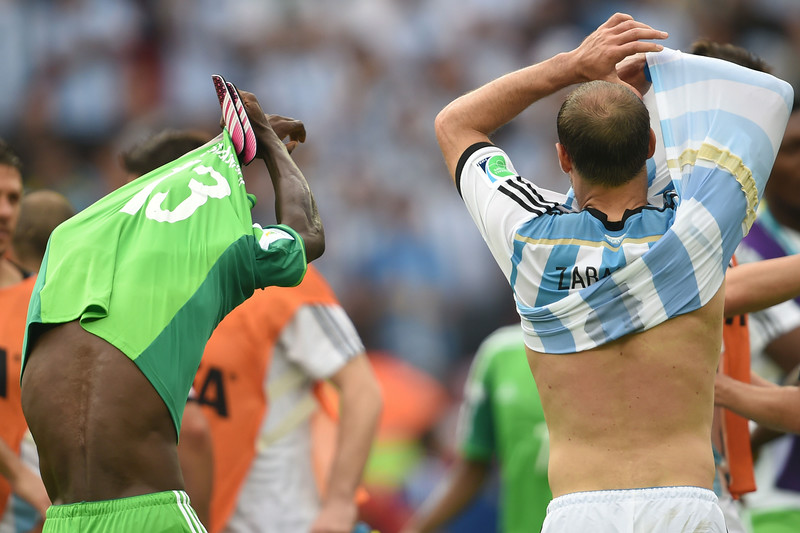 . Nigeria\'s defender Juwon Oshaniwa (L) and Argentina\'s defender Pablo Zabaleta exchange jerseys after their Group F football match between Nigeria and Argentina at the Beira-Rio Stadium in Porto Alegre during the 2014 FIFA World Cup on June 25, 2014.  (PEDRO UGARTE/AFP/Getty Images)