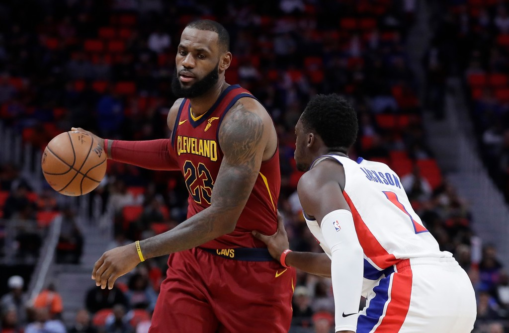 . Cleveland Cavaliers forward LeBron James (23) controls the ball next to Detroit Pistons guard Reggie Jackson (1) during the second half of an NBA basketball game, Monday, Nov. 20, 2017, in Detroit. (AP Photo/Carlos Osorio)