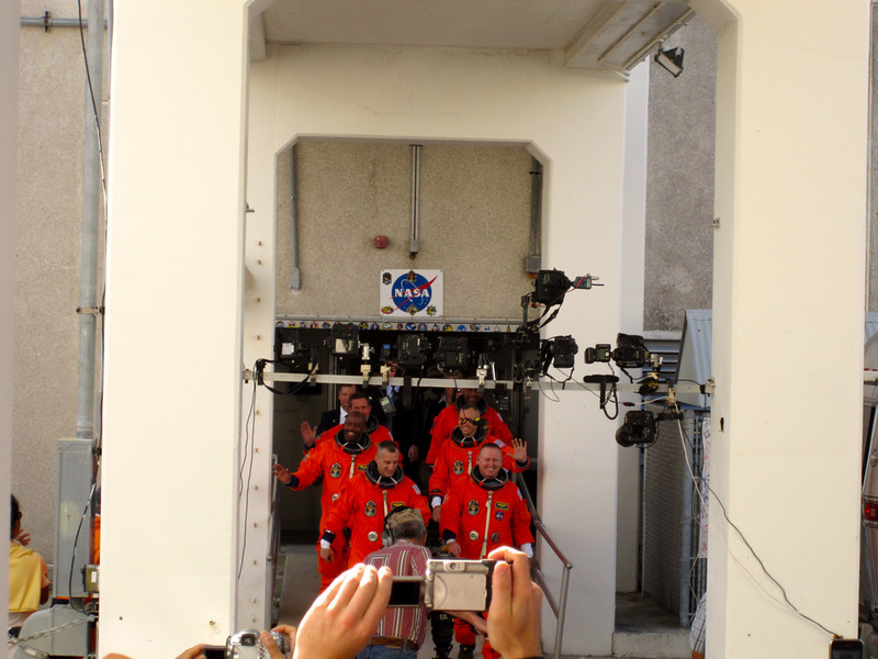 10:38am - the astronauts emerge from quarantine and head for the waiting Airstream transport. Photo by Jim Lovett