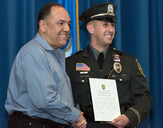 05/15/18 Wesley Bunnell | Staff Berlin Police held their 2018 Awards Ceremony on Tuesday May 15th at Eversource Energy at 107 Selden St. Officer Brandon Lagueux smiles as he receives his Lifesaving Award from citizen Louis Rivera for his role in helping to save Rivera's life.