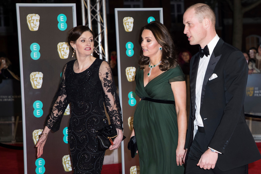 . Britain\'s Kate, the Duchess of Cambridge, centre, and William, Duke of Cambridge, right, arrive with Chief Executive of BAFTA Amanda Berry at the BAFTA Awards 2018 in London, Sunday, Feb. 18, 2018. (Photo by Vianney Le Caer/Invision/AP)