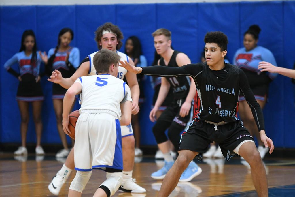 . Patrick Hopkins - The News-Herald Action from VASJ-Trinity boys basketball Feb. 2.