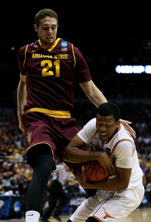 . Martez Walker #24 of the Texas Longhorns rebounds against Eric Jacobsen #21 of the Arizona State Sun Devils in the first half during the second round of the 2014 NCAA Men\'s Basketball Tournament at BMO Harris Bradley Center on March 20, 2014 in Milwaukee, Wisconsin.  (Photo by Jonathan Daniel/Getty Images)