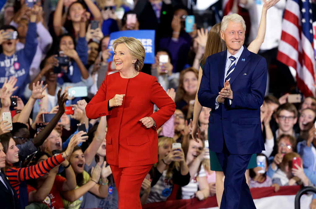 . Democratic presidential candidate Hillary Clinton and husband, former President Bill Clinton take the stage during a campaign rally in Raleigh, N.C., Tuesday, Nov. 8, 2016. (AP Photo/Gerry Broome)