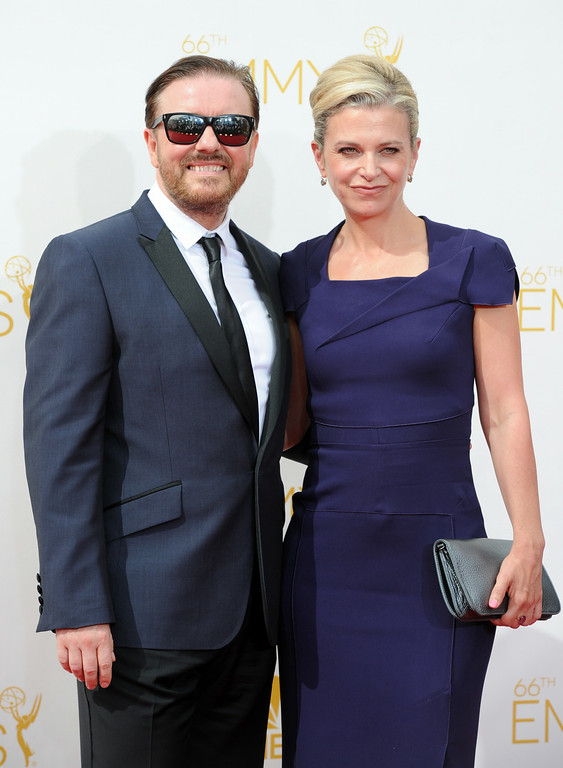 . Ricky Gervais (L) and Jane Fallon on the red carpet at the 66th Primetime Emmy Awards show at the Nokia Theatre in Los Angeles, California on Monday August 25, 2014. (Photo by John McCoy / Los Angeles Daily News)