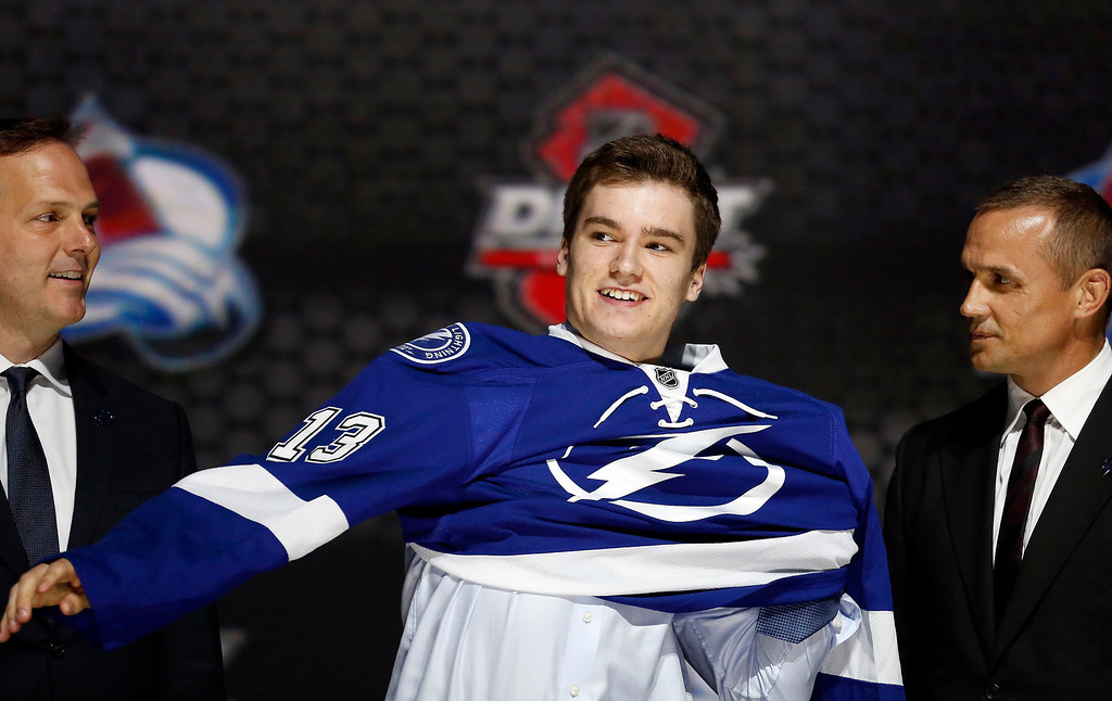 . Jonathan Drouin puts on a Tampa Bay Lightning jersey after he was selected by the Lightning as the third overall pick in the 2013 National Hockey league (NHL) draft in Newark, New Jersey, June 30, 2013. REUTERS/Brendan McDermid