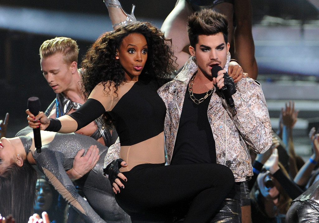 ". LOS ANGELES, CA - DECEMBER 16:  (L-R) Singers Kelly Rowland and Adam Lambert perform onstage during ""VH1 Divas\"" 2012 at The Shrine Auditorium on December 16, 2012 in Los Angeles, California.  (Photo by Kevin Winter/Getty Images)"