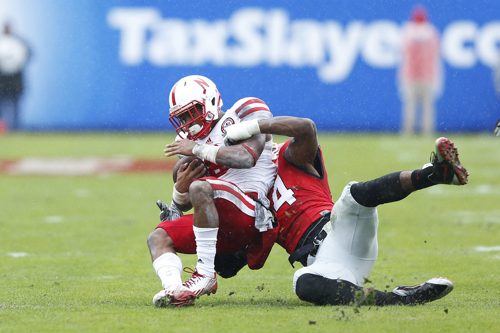 . Ameer Abdullah #8 of the Nebraska Cornhuskers is tackled by Brendan Langley #4 of the Georgia Bulldogs in the first half during the TaxSlayer.com Gator Bowl at Everbank Field on January 1, 2014 in Jacksonville, Florida. (Photo by Joe Robbins/Getty Images)