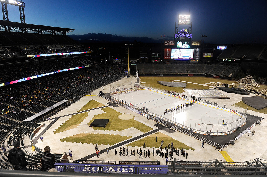 . Colorado College lines up on the blue line during introductions before their game against Colorado College at Coors Field in Denver, Colorado on February 20, 2016. (Photo by Seth McConnell/The Denver Post)