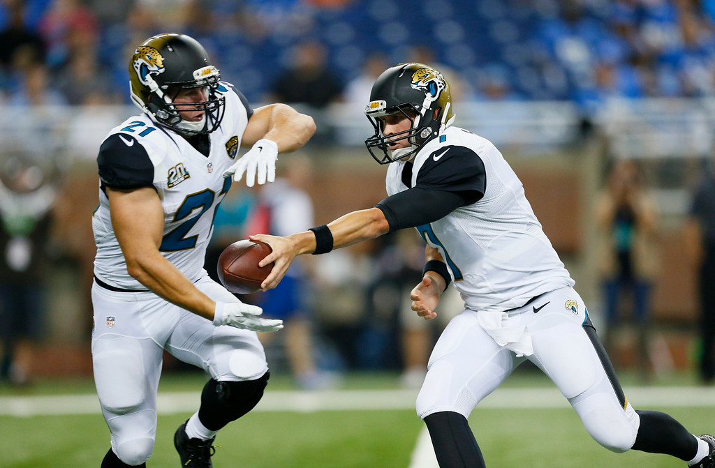 . Jacksonville Jaguars quarterback Chad Henne (7) hands off to running back Toby Gerhart (21) against the Detroit Lions in the first half of a preseason NFL football game at Ford Field in Detroit, Friday, Aug. 22, 2014. (AP Photo/Rick Osentoski)